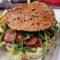 200gJack Daniels Burger s chedarem, křupavou slaninou, omáčkou Jack Daniels, smaženými hranolky a salátkem coleslaw
